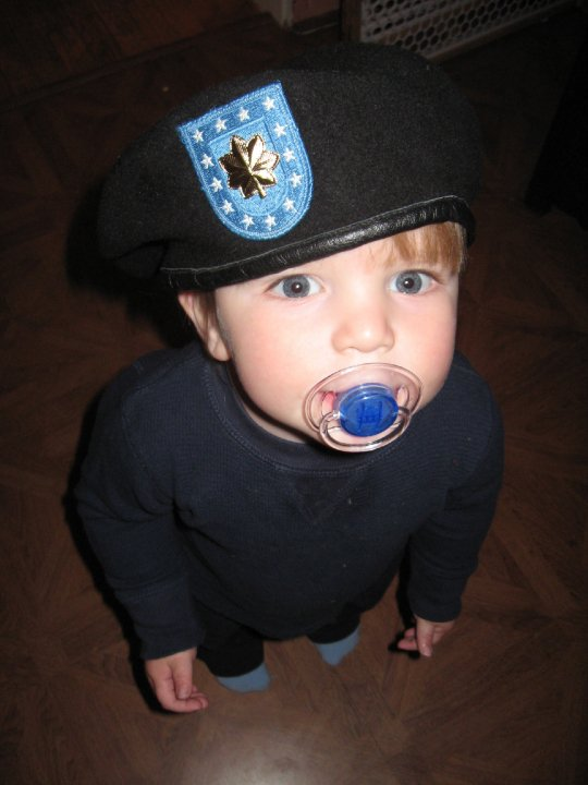 When Allen was promoted to Major in the field in Afghanistan, the kids and I celebrated for him at home. We sent him this picture of his son (who didn't remember him) wearing his new rank.