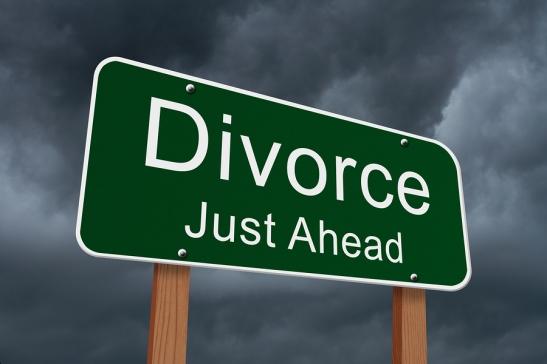 Divorce Just Ahead Sign Green highway sign with words Divorce Just Ahead with stormy sky background